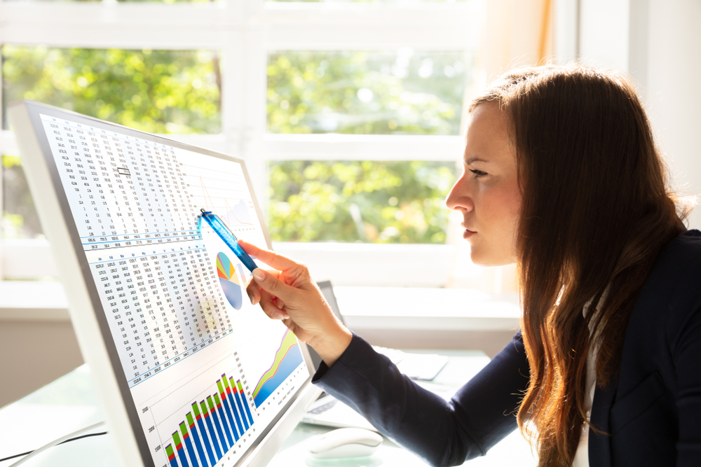 Woman looking at data on computer screen