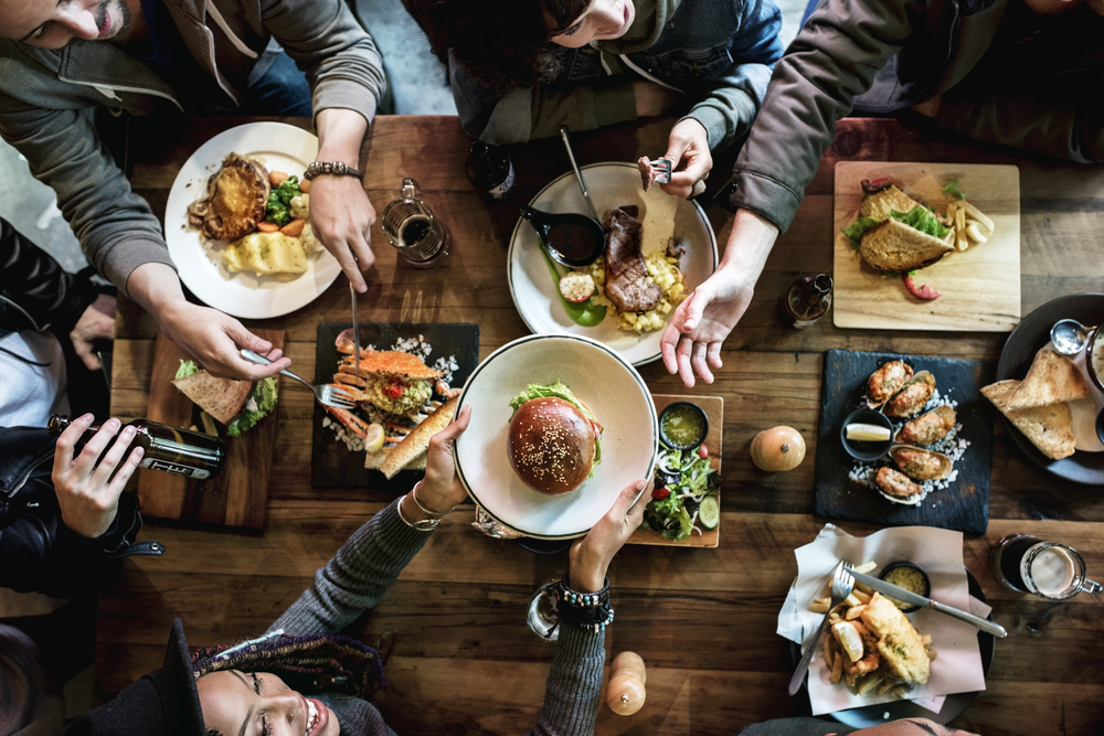 bird's eye view of people eating at a table