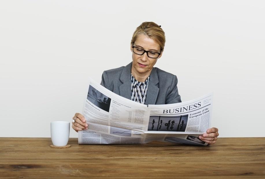 Stock-businesswoman-read-newspaper-442024-edited.jpg