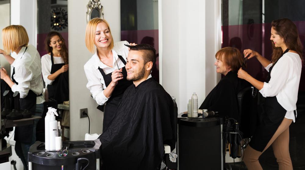 Stylist cutting clients hair at a salon